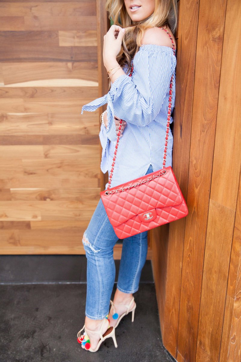 off-shoulder-top-ripped-denim-red-chanel-bag