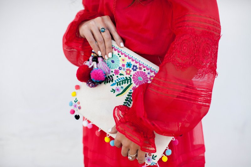 embroidered-pom-clutch