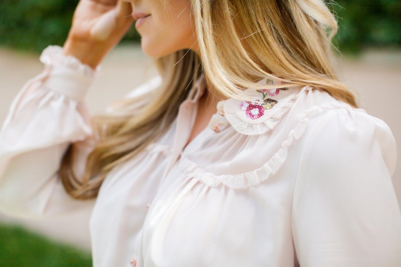 embellished pink blouse